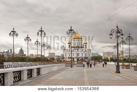 Moscow Russia -September 09 2016: Christ Temple Saviour. Citizens go through Patriarchal bridge