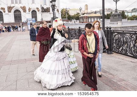 Moscow Russia -September 092016: Roma women in ancient dresses make a fool of Tibetan monks at the Patriarchal bridg