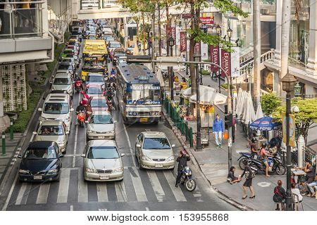 Cars Stop At A Traffic Light And Wait For Green Light In Bangkok