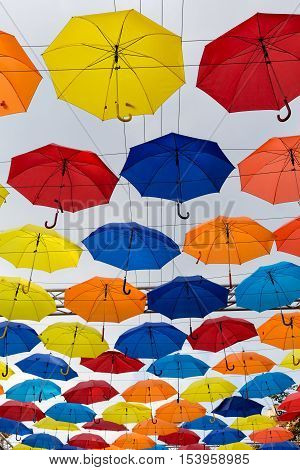 Colorful umbrellas background. Colorful umbrellas in the sky. Street decoration.