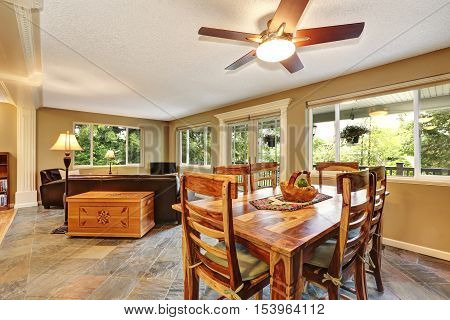 Open Plan Dining Room With Rustic Wooden Table Set
