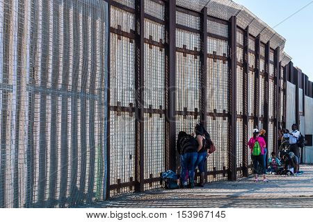 SAN DIEGO, CALIFORNIA - OCTOBER 22, 2016:  Friendship Park international border wall separating San Diego from Tijuana, where people gather to communicate with loved ones through the fence.
