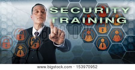Assertive corporate manager is activating SECURITY TRAINING on a virtual control screen. Business metaphor and information technology concept for instruction of employees in computer security.