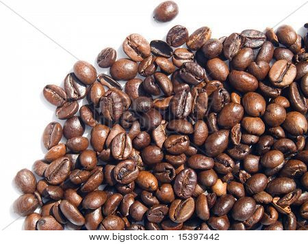 Close-up of coffee grains texture isolated on white