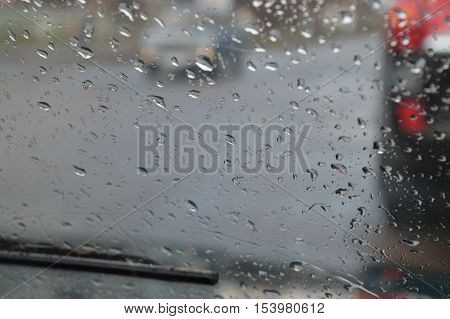 Drops of the rain on the windshield of the car