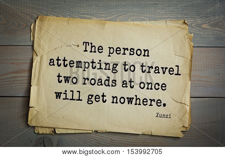 Top 25 quotes by Xun Zi, a Chinese thinker Confucian tradition.  The person attempting to travel two roads at once will get nowhere.
