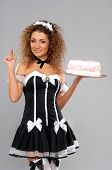 Beautiful Waitress With A Cake On A Tray