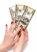 foto of holding money  - Two woman hands holding dollars - JPG