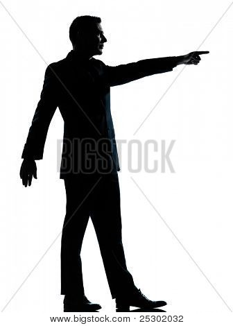 one caucasian business man silhouette standing poiting  Full length in studio isolated on white background