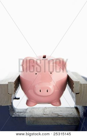 Piggy bank in a vice