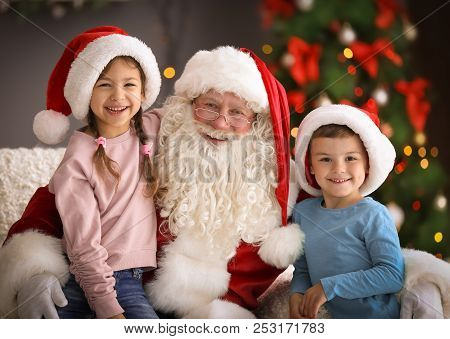 poster of Little Children Sitting On Authentic Santa Claus' Knees Indoors