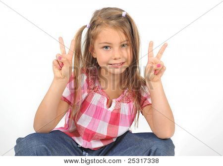 little girl with hand peace symbol