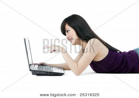 Cute Young Female Pointing At Laptop