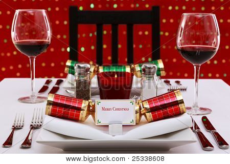 Photo of a restaurant table with Christmas place settings with crackers and name card, the card was designed by myself with space to add your own text.