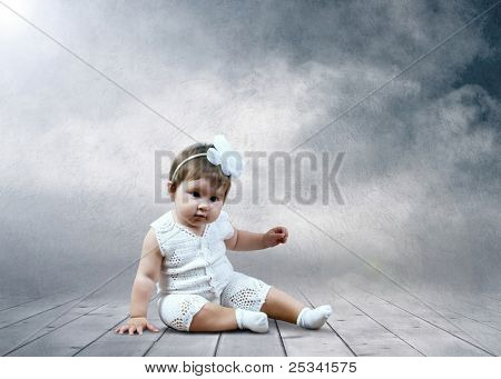 Child sitting with globes in hands