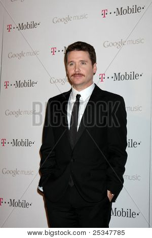 LOS ANGELES - NOV 16:  Kevin Connolly arrives at the Google Music Launch at Mr. Brainwash Studio on November 16, 2011 in Los Angeles, CA