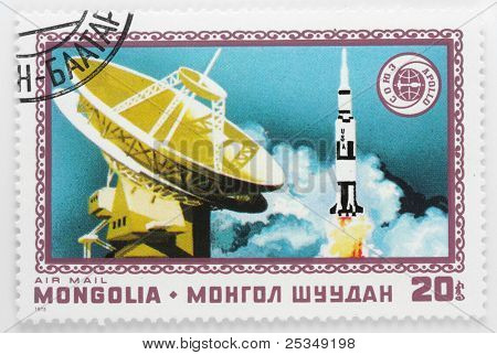 MONGOLIA - CIRCA 1976: A stamp printed in Mongolia shows launching rocket Saturn 1B with spaceship Apollo ASTP Apollo–Soyuz Test Project, circa 1976.