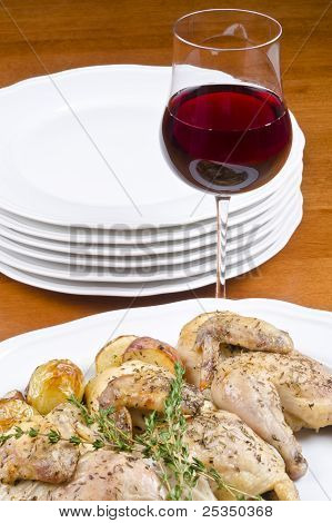Roasted Cornish Hen and Potatoes Served with Red Wine