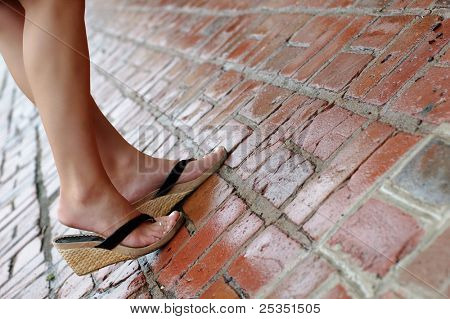 Close up of womans feet on sidewalk.
