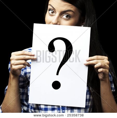 portrait of young woman with question paper on black background
