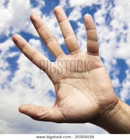 hand symbol against a blue sky background