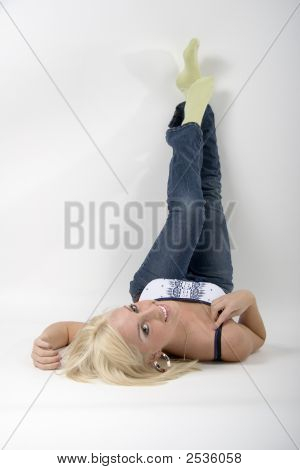 Blonde Girl Lying On Her Back