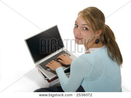 Pretty Teenage Girl Using Laptop Computer