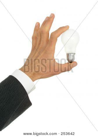 Businessman's Hand eine Glühbirne, die