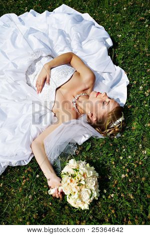 Happy Sleeping Bride Are On Grass