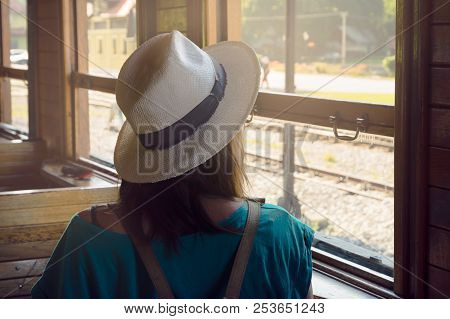 poster of Girl in vacation. Traveler girl watching through train window. Young traveler girl in vacation. Girl traveling by train in vacatio. Traveler girl observing landscape through window. Travel. Girl. Train. Traveler. Vacation
