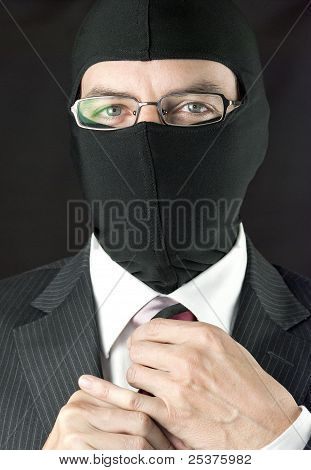 Businessman In Balaclava Adjusts Tie, Close