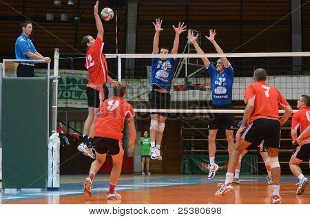 KAPOSVAR, HUNGARY - NOVEMBER 13: Unidentified players in action at a Hungarian National Championship volleyball game Kaposvar (blue) vs. Nyiregyhaza (red), November 13, 2011 in Kaposvar, Hungary.