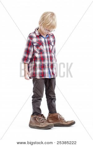 Boy In Father´s Shoes