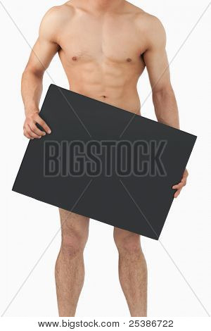 Sporty male body holding banner in his hands against a white background