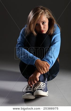 Scared Teenager Girl On Floor Stressed And Alone
