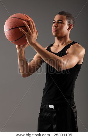 Young Black Man Shooting Hoops With Basketball