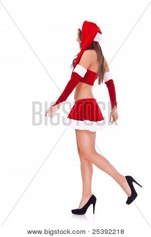 Side View Of A Sexy Santa Walking