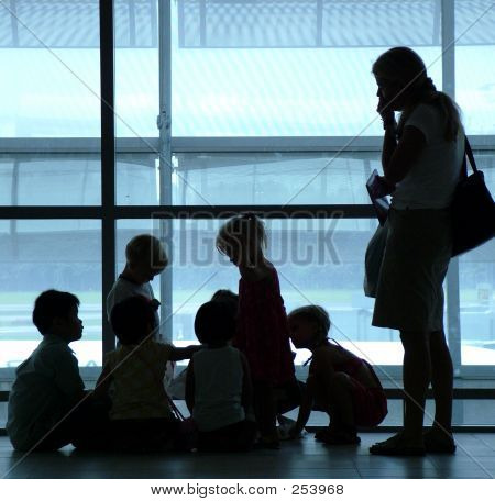 Silhouette Of A Family At Airport
