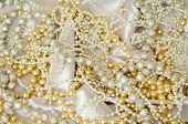image of gold glitter  - String of pearls on silk background - JPG