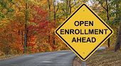 Open Enrollment Caution Sign With Autumn Road Background poster