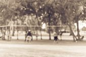 Vintage Blurred Group Of Latin America Outdoor Volleyball Players poster