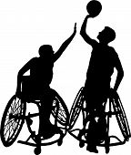 stock photo of physically handicapped  - Two physically challenged male athletes playing wheelchair basketball - JPG