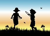 stock photo of children playing  - silhouette of two yong girls skipping with hula hoops in the grass - JPG