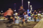 Abstract Silhouettes Of Group Colorful Cyclists On City Streets, Abstract, Motion Blur, Bike Festiva poster