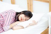 Portrait Of Beautiful Asian Young Woman Sleep Lying In Bed With Head On Pillow Comfortable And Happy poster