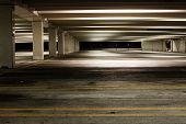 stock photo of dingy  - Empty parking garage at night - JPG