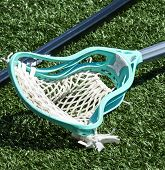 A High School Boys Aqua Blue Lacrosse Stick Lying On The Ground. poster