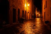 Old European Illuminated Street At Rainy Night poster