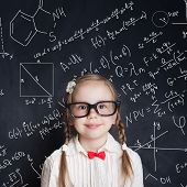 Little Genius. Smart Little Girl Math Student On School Blackboard Background With Hand Drawings Sci poster
