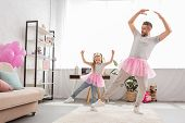 Funny Father And Daughter In Pink Tutu Skirts Dancing Like Ballerinas poster